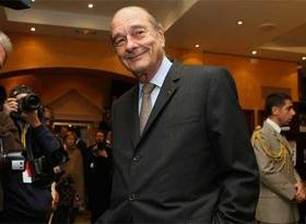 chirac_sonrie_anoche_inicio_24_cumbre_jefes_estado_africanos_francia_cannes.jpg