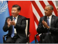 epa05521727 US President Barack Obama (R) and Chinese President Xi Jinping clap as UN Secretary General Ban Ki-moon  (not pictured) delivers his speech during a joint ratification of the Paris climate change agreement ahead of the G20 Summit at the West lake State Guest House in Hangzhou, China, 03 September 2016. The G20 Summit will be held in Hangzhou on 04 to 05 September.  EPA/HOW HWEE YOUNG